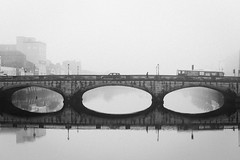 Cork on a foggy morning No. 2 (Pat Kelleher) Tags: cork fog mist grain black white blackwhite blancoynegro schwarzweiss schwarz bridge river canon mono reflection