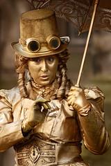 DSC_7945aa - The Edinburgh Fringe 2016 - Miss Marigold (henryhulley) Tags: d80nikon nikonuser nikon scotland edinburghfringe edinburghfringe2016 edinburghfestivalfringe edinburghfestivalfringe2016 missmarigold royalmile royalmileedinburgh dressingup dressup gold makeup art artist costume cosplay color golden prettygirl pretty beautifullady beautiful beautifulmodel model dof narrowdof streetperformer performer