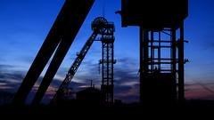 Silhouette of hoist frames (lutzmarl) Tags: flickr friday silhouette nikon d7000 sigma 1770 makro hdr blaue stunde vienx2 pse frderturm bergwerk bergbau neukirchen vluyn