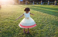 ... (Saptak Ganguly) Tags: activity autumn backlight child childhood costume dance extended fall fashionable field free freedom frock fun grass hands happy innocent light littlegirl outdoors park play pretty season skirt smile spin summer sun sunlight twirl