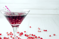 Pomegranate martini with pomegranate seeds in a glass (lyule4ik) Tags: