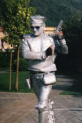 Il pistolero (sirio174 (anche su Lomography)) Tags: streetartist artistadistrada lungolago promenade como argento silver pistolero