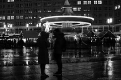 Meeting by the carousel (frune_man) Tags: greyscale berlin bw carousel drizzle germany niemcy night