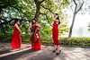 Ladies in red (PaulHoo) Tags: red backlit nikon d700 light illuminated fashion beauty dress artist musician voilin 2016 vietnam hanoi city urban candid streetcandid color vibrant morning saturized hoan kiem lake shadow lady beautiful play women woman