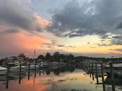 Marina at Sunset (ymnusa) Tags: southernmaryland calvertcounty chesapeake sky moodysky storm rain clouds silhouette reflection landscape outdoors nature chesapeakebeach maryland boats blue pink marina sunset