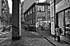 """Murals"" (giannipaoloziliani) Tags: strada monocromo biancoenero architettura downtown viuzza turincity turin torino street city città blackandwhite monochrome urban urbanstreets shop murals murales walls muri spray pictures cars motors architectures people persone marciapiede piedimont piemonte italia italy italianstreets column colonna prospettica prospettiva perspectives angle angolo streetphoto streetphotography urbanart urbanblackandwhite streetlife citylife urbanlife nikond3200 nikoncamera nikon scritte written scrittesuimuri sidewalks windows negozio store streetart portico arcade flickr captures pegeon piccione walk"