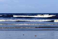 Rolling In (KatieWhitaker) Tags: ocean blue sky white beach gulfofmexico water coast sand waves texas jetty clear galvestonisland foreground