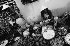 . (robbie-69) Tags: street ladies blackandwhite bw white black fruit vietnamese market hats streetphotography an vietnam hoian vegtables garlic hoi conical blackandwhitephotography sellers traders