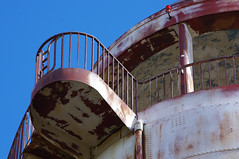 (Shane Henderson) Tags: old blue roof light red sky architecture stairs spiral peeling top watertower steps rusty staircase dome worn weathered column railing distressed crusty northpark mccandlesstownship