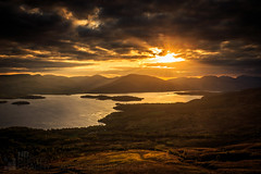 View from Conic Hill (GenerationX) Tags: sunset sky mountains water clouds landscape evening scotland unitedkingdom dusk scottish neil rays trossachs lochlomond cobbler barr luss glendouglas inchcailloch drymen conichill arrocharalps inchlonaig glenfinlas inchmurrin glenluss milarrochy