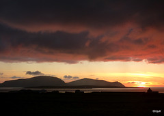 Dramatic Sunset Clouds Over Hoy (orquil) Tags: dramatic sunset clouds thick dense layered dark colours bright lower sunlit golden sky skyscape cloudscape hoy large hills silhouette lowlying graemsay island sea seaside scapaflow clestrainsoundforeground farmland farm buildings hallofclestrain shadow westmainland orkney islands scotland uk unitedkingdom greatbritain orcades unusual interesting landscape memorable evening autumn october