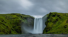 Force of Nature (MJSAFC10) Tags: iceland icelandic waterfall waterfalls water nature force skogafoss landscape landmark outdoor outdoors longexposure cloud clouds cloudscape nikon travel backpacker nationalgeographic exploring hill mountain hike mist moody holiday river rock cliff cliffs