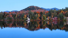 Lake Placid cottages in autumn (duaneschermerhorn) Tags: trees foliage nature colors fall autumn reflection mirror colorscolorful leaves turning changing sky blue red green gold adirondacks placid lake lakeplacid mirrorlake cottage water shore