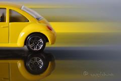 beetle... (ggcphoto) Tags: beatlesbeetles macromondays toycar vwbeetle yellow blur motion reflection inexplore