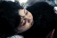 Cupid (EEAworkshop) Tags: portrait kid kids sleeping boy baby asleep sleep lovely cute street people bokeh art child face messy black hair peaceful calm beautiful arabic arab children mecca makkah saudi saudiarabia outdoor outdoors travel explore