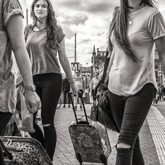 tourists on the move (Gerard Koopen) Tags: nederland netherlands amsterdam city centraalstation centralstation straatfotografie streetphotography straat street candid people woman women tourist tourists toerist toeristen luggage suitcase koffer bw blackandwhite fujifilm fuji xpro1 35mm 2016 gerardkoopen