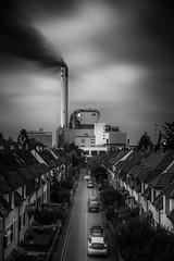 El que (blondmao) Tags: building bnw switzerland industry clouds longexposure terracedhouses road dark bw sky architecture chimney combustionplant blackandwhite 13stopper basel