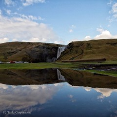Slightly different perspective of Skógafoss Waterfall.  A #puddlegram from the car park...