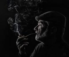 lost in thought (marianna_Florida-bound) Tags: pipe smoke smoker man portrait desaturated monochromatic blackwhite blackwhitephotos blackandwhite senior profile face hand dark mariannaarmata p3030890 pensive thought