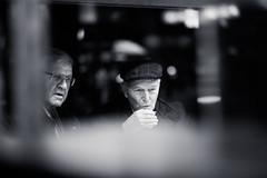 Hot Drink (Ivan Rigamonti) Tags: zurichmainstation street bnw switzerland streetphotography standing urbanexploration cold man urban monochrome flickr 500px bw booth zurich blackandwhite europe people zürich schweiz ch ivanrigamonti