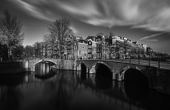 Couldn't be more typical... (miguel_lorente) Tags: holland trees houses netherlands bridges water clouds bw bnw longexposure blackandwhite amsterdam canals