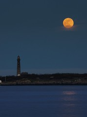 Full moon with lighthouse and reflection (mehjg) Tags: moon lighthouse mist ma island massachusetts moonrise rockport capeann supermoon