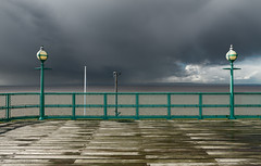 Clevedon Pier & a Welsh Storm 1 (welshio) Tags: light sea england storm green water wales clouds fence coast pier teal dramatic stormy estuary severn boardwalk bleak thunder clevedon lampposts bristolchannel endofpier