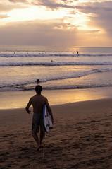 Sunset surfing at Kuta Beach, Bali