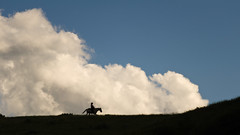 Cowboy (musubk) Tags: horse silhouette clouds nationalpark cowboy theodorerooseveltnationalpark