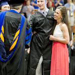 "<b>Chris Norton walks across the stage to collect his deploma.</b><br/> Chris Norton graduates with the class of 2015 and walks across the stage to recieve his deploma with the assistance of his girlfriend and a standing ovation from the crowd. Photo by Aaron Lurth.<a href=""http://farm6.static.flickr.com/5455/17425079914_5004555c0c_o.jpg"" title=""High res"">∝</a>"