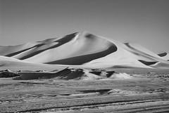 Sand dunes (Hamza Bendahmane) Tags: africa travel sky bw sahara nature landscape algeria sand nikon desert dunes dune sable nobody land algerie scenics     notjustlandscapes
