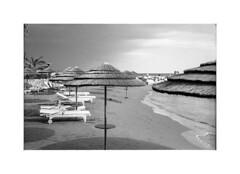 *** (Gediminas Bernotas) Tags: bessar cyprus limassol kodaktrix tetenalultrafin push iso1600 beach autumn sea shore beachumbrella beachchair