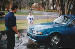 WASHING THE CAVALIER IN 1996 (richie 59) Tags: ulstercountyny ulstercounty newyorkstate newyork unitedstates autumn generalmotors chevrolet townofesopusny townofesopus richie59 america outside frontyard fall chevycavalier cavalier oldphotograph olddays oldphoto 1988chevycavalier 1988cavalier 1988chevy 1996 photoscan nov101996 non1996 35mmfilm 35mm filmcamera filmphotography film 1990s 1980scar americancar uscar 4door 4doorsedan fourdoor fourdoorsedan sedan bluecar chevysedan chevy automobile auto car motorvehicle vehicle hudsonvalley midhudsonvalley midhudson nystate nys ny usa us carwashing washingcar soapy wet cleaning washing dented dent dentedfender trees