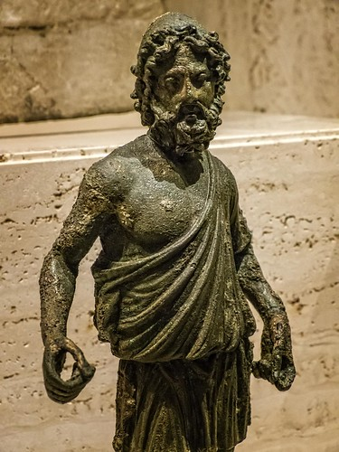 Closeup of Statuette of Hephaestus the god of fire and patron of jewelers, armorers and blacksmiths Roman copy of a Greek original 1st - 2nd century CE Bronze