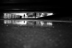 another rainy day... (maekke) Tags: zürich limmat bridge underground reflection silhouette man umbrella availablelight pointofview pov streetphotography 2016 fujifilm x100t ch switzerland bw noiretblanc