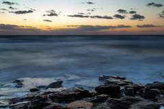 Windswept Dawn (John Cothron) Tags: ocean cloud beach water rock seashells sunrise 35mm canon landscape dawn spring twilight sand unitedstates florida scenic wave windy atlanticocean saltwater seafoam calcite sunshinestate coquina palmcoast flaglercounty washingtonoaksgardensstatepark johncothron 5dmkii cothronphotography zeissdistagont352ze 2jtrip20121 johncothron img09346120407