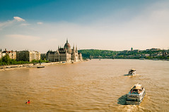 Danube river (Ajan Alen) Tags: old city travel bridge sky urban panorama building tourism water architecture river landscape boats flow daylight town europe hungary day ship cityscape view traffic ships famous capital budapest sightseeing parliament enjoy destination magyar eastern danube pest easterneurope hungarian bosniaandherzegovina rivertraffic