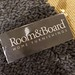 Room and Board Home Furnishings Label on Brown Pile Rug