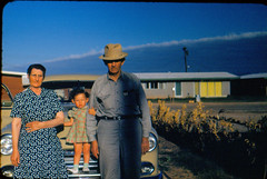Older couple and child by car (sundogrr) Tags: grandma people house hat outdoors fifties child grandmother grandfather grandpa grandparents 1950s older
