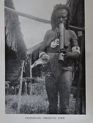 Goaribari smoking a pipe - Prowling through Papua by Frank Clune 1948 (AndyBrii) Tags: history 1948 book australian ww2 inscription newguinea natives jamescoomber frankclune prowlingpapua
