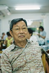 000013 (iheresss) Tags: portrait 35mm relax thailand glasses nikon kodak bangkok oldman indoor filmcamera nikonf portra400 manuallens analogfilm
