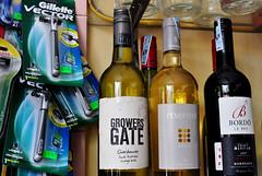 Cut-throat business (Roving I) Tags: tourism shops retail razors gillette wines mixture juxtaposition hoian vietnamgrowersgate novement bordo