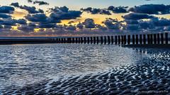 Sunset Ameland (JnHkstr) Tags: ameland fotoclub gespot sunset zonsondergang hollum beach strand wolken clouds lucht paaltjes water sea waddenzee