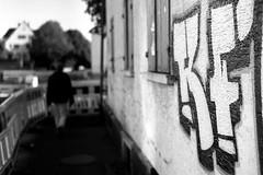 Walking man (Leica M6) (stefankamert) Tags: stefan kamert mood bw baw sw black white schwarz weis street leica m6 m rangefinder mirrorless voigtlnder nokton ilford fp4 film analog scan epson v550 negative grain einfarbig outdoor noir monochrome leicam6 noiretblanc walking man blurred dof
