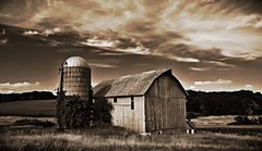 browntown... (BillsExplorations) Tags: browntown wisconsin barn barnsandfarms silo old abandoned discarded forgotten sky clouds abandonedfarm sepia