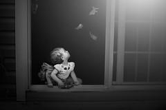 Autumn Wonders (Kapuschinsky) Tags: baby infant child curiosity wonder gaze leaves autumn fall door doorway framed ruleofthirds profile sony sonya700 minolta sonyalpha blackandwhite bnw monochrome fineart portrait fineartportrait portraiture blackandwhitefineart
