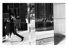 business in Hong Kong (handheld-films) Tags: hongkong reflections business mirror glass offices abstract man stride striding suit monochrome blackandwhite chine chinese asia fareast reportage documentary