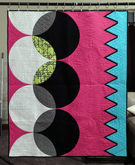 The Cool Kids 2 (Quiltachusetts - Heather Black) Tags: modern contempory quilt shocking hot pink aqua blue gren black white solids curved curves triangle transparency walking foot straight line quilting geometric