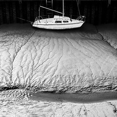 Stranded (Haddraniel) Tags: boat harbour sand mud bw tide low stranded texture rye water