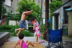 Jump () Tags: china camera leica people childhood garden children lens jump wuxi snapshot documentary rangefinder reportage streetshot m9 carlzeiss zm leicam9 csonnart1550 gettychinaq2
